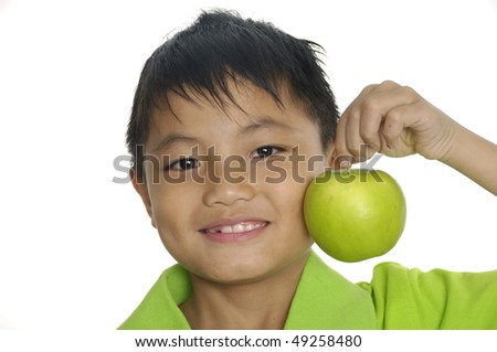 boy holding a big green apple - stock photo