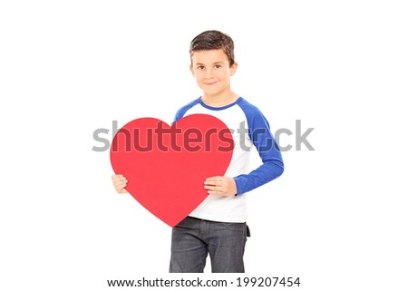 Boy holding a big red heart isolated on white background - stock photo