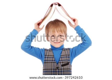 Boy holding a book over his head isolated on white