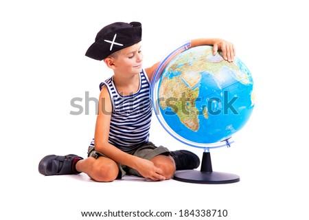 Boy holding a globe  isolated on white background - stock photo