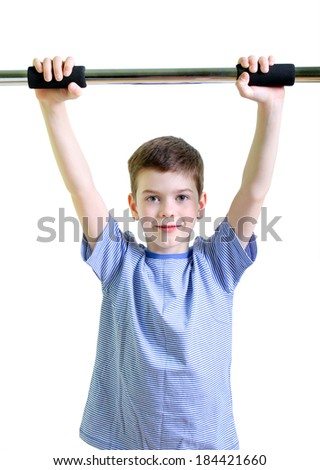 Boy holding a metal bar above his head over white background - stock photo