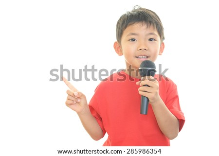 Boy holding a microphone