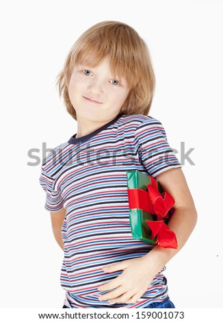 Boy Holding a Present - Isolated on White