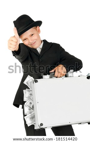 boy holding a suitcase full of money insulated on white - stock photo
