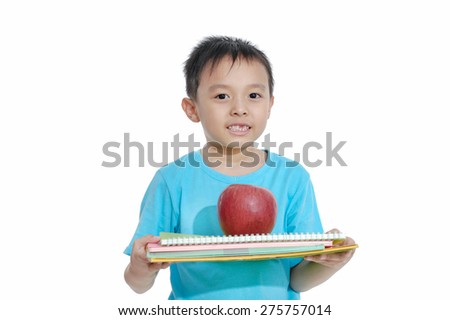 boy holding apple and notebook isolated - stock photo