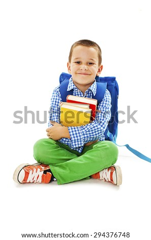 Boy holding books. Isolated on a white background - stock photo