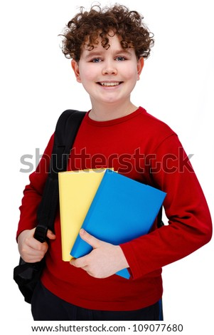Boy holding books isolated on white background