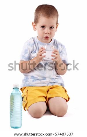 Boy holding bottle of water isolated on white background - stock photo