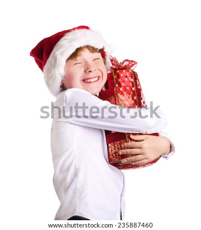 Boy holding Christmas present with happy expression on his face. Christmas, new year, x-mas concept - stock photo