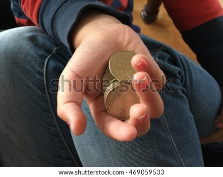 Boy holding coin giving mother.
