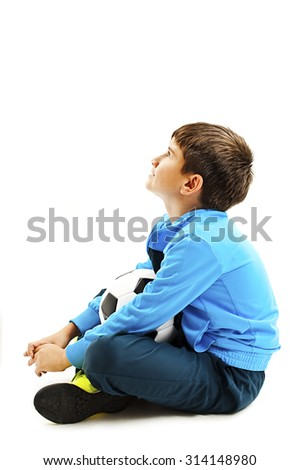Boy holding football, looking up. Isolated on a white background. Soccer ball