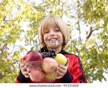 boy holding fruit - stock photo