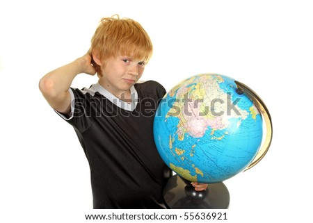Boy holding  globe in hand against white background