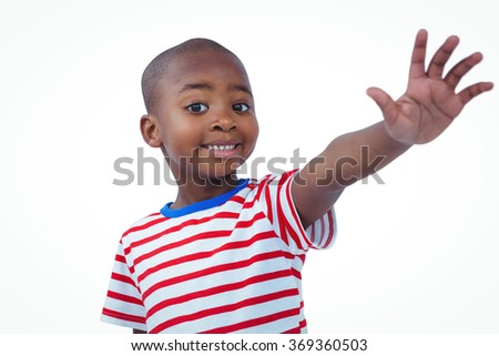 Boy holding his hand on the camera on white screen