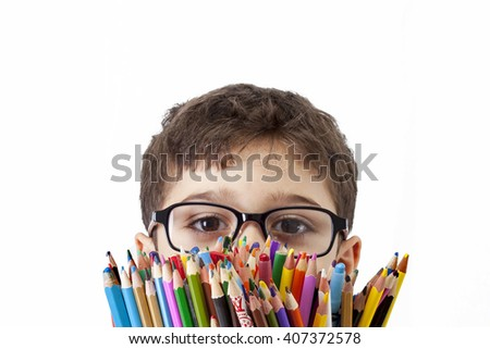 Boy holding many collared pencils isolated on white background