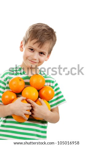 Boy holding oranges isolated on white background - stock photo