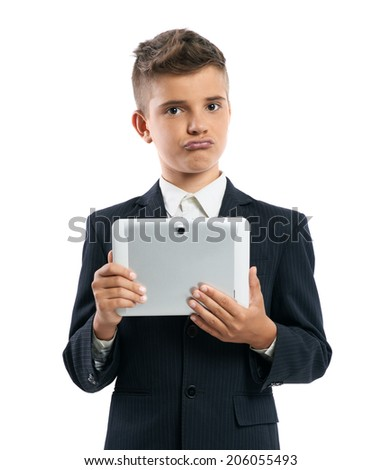 boy holding tablet computer in and shows duckface isolated