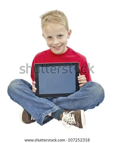 Boy holding tablet pc - stock photo
