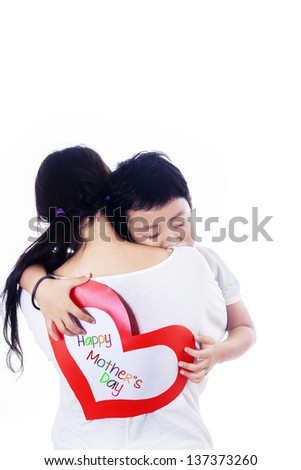 Boy hug mother holding love card on white background - stock photo