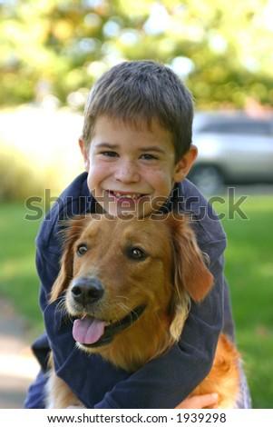 Boy Hugging Dog - stock photo