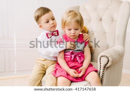 Boy hugging girl - stock photo