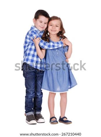 boy hugging the girl  full length portrait on white - stock photo