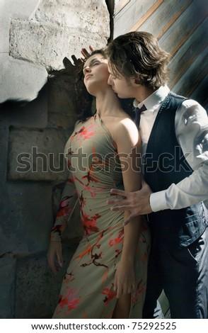 boy hugs a girl on the street - stock photo