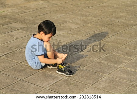 Boy hurt his leg - stock photo