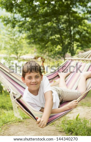 boy in a hammock on the nature