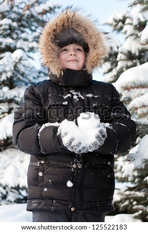 Boy in a snowy forest