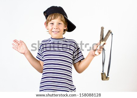 boy in a striped shirt and baseball cap holding hands in slingshot