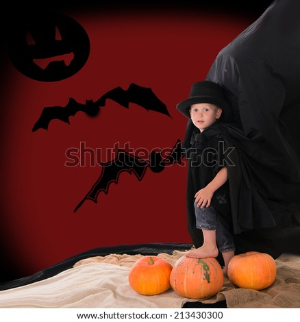 boy in a suit of Count Dracula on Halloween