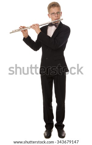 Boy in a suit playing a flute