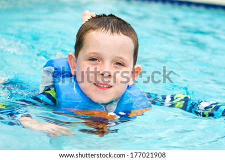 Man Rowing In Inflatable Kayak Kids Floating On Inflatable Cute Male Models Picture