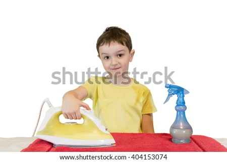 Boy in a yellow t-shirt ironed red towel, housework on white background. - stock photo