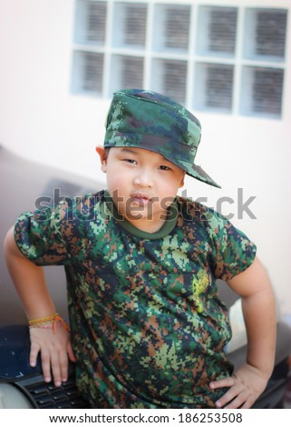 Boy in army clothing - stock photo