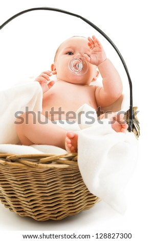 boy in basket isolated on white