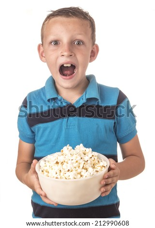 boy in blue shirt in studio eating popcorn - stock photo