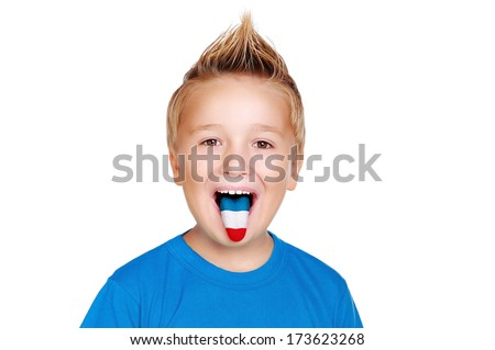 boy in blue shirt with french flag on his tongue