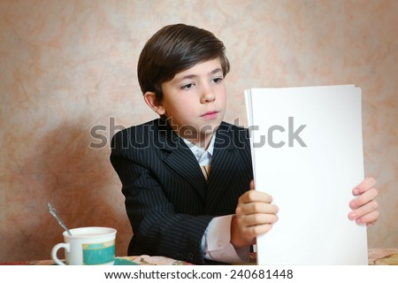 boy in businessman suit work with paper