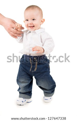 boy in clothes makes first steps isolated on white background - stock photo