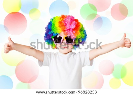 Boy in colored wig, background color of the circles - stock photo