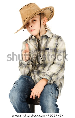 boy in cowboy hat with finger guns shooting you