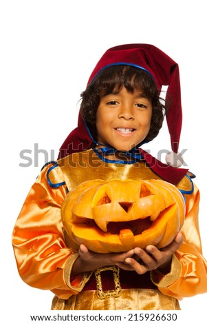 Boy in dwarf costume with carved pumpkin  - stock photo