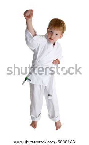 boy in gi making karate moves over white with clipping path