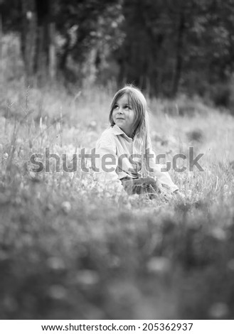 boy in grass black and white photography