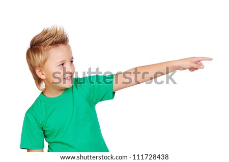 Boy in  green tshirt pointing with his fibger - stock photo