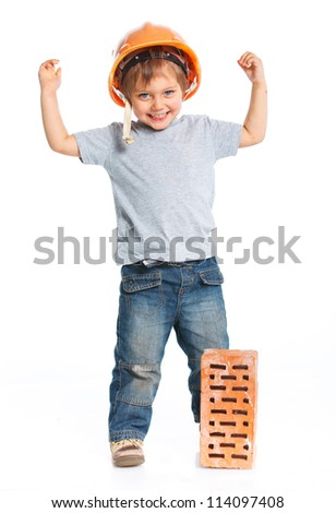 Boy in hard hat with brick. Isolated white backround - stock photo