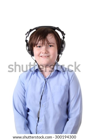 Boy in headphones isolated on white background - stock photo