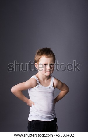 boy in his arms akimbo - stock photo
